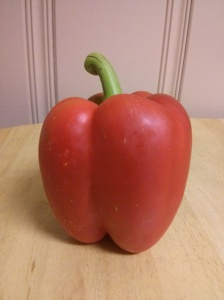 An upstanding red pepper
