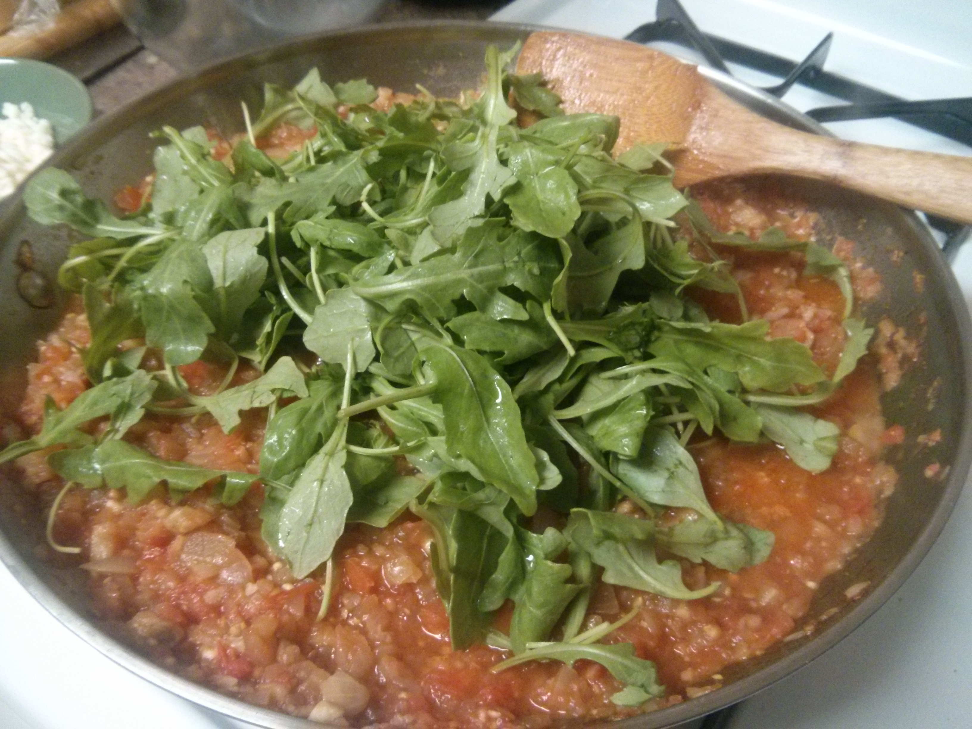 ... ingredients: the arugula, bread crumbs, and Parmesan and mozzarella